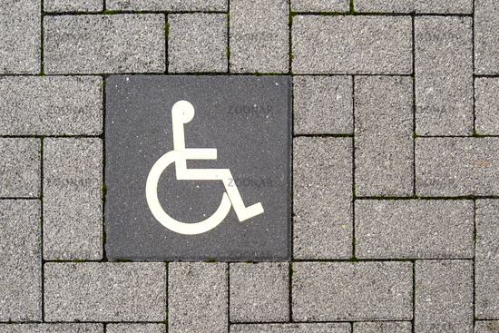 Pictogram disabled parking on paving stones