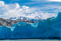 Blue Iceberg of Grey Glacier on Grey Lake and snowy mountain at Torres del Paine National Park
