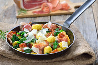 Gnocchi with spinach and fried bacon
