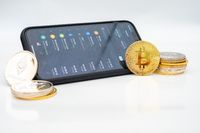 Cryptocurrency stock market app open on a smartphone