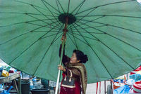 Woman setting up an umbrella