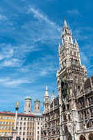 The New City Hall at the Marienplatz in Munich with the towers of the Frauenkirche in the back