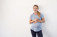 Confident relaxed attractive young pregnant woman