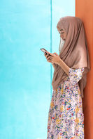 Asian Muslim student use mobile phone