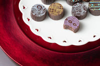 Artisan Fine Chocolate Candy On Serving Dish with Heart Design