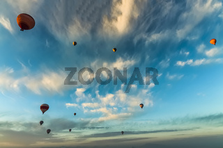 Bottom up view of hot air balloons flying over Cappadocia