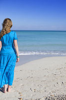young woman in a romantic dress on sand near the sea, Cuba, Varadero