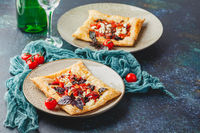 Tomato tarts with addition of aromatic herbs