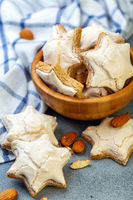 Christmas almond cinnamon cookies in a wooden bowl.