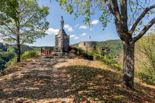Ardennes hill with memorial statue near Village Esch-sur-Sure in Luxembourg