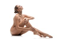 Naked girl sitting on the floor view
