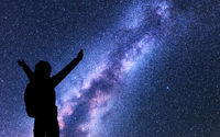 Milky Way. Silhouette of a happy woman. Space