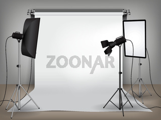 Realistic photo studio set up with lighting equipment and white backdrop