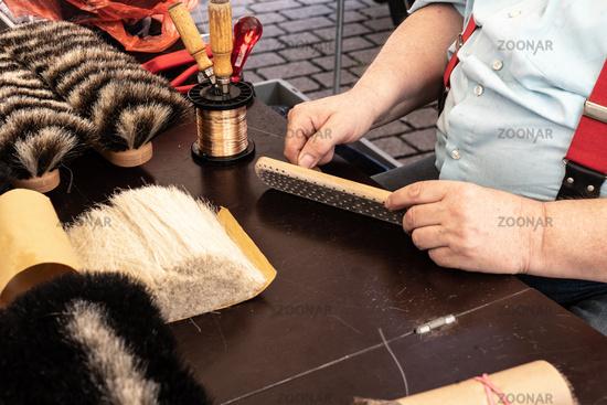 Brush binder when making a broom