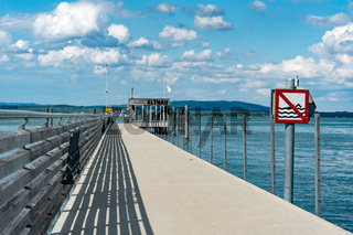 close up view of  the long pier at Altnau on Lake Constance with a no swimming sign because of passenger ship traffic routes