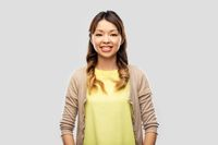happy asian woman over grey background