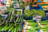 Courgette, spring onions and other vegetables for sale at a market in London