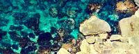 Horizontal image above view turquoise sea bay lagoon surrounded by stone formations