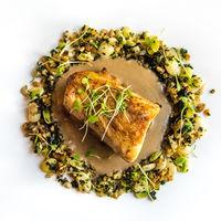 Delicious fish dish at gourmet restaurant