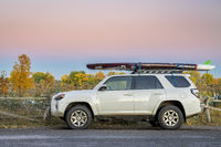 Toyota 4Runner SUV with stand up paddleboard