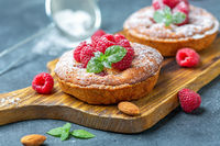 Delicious mini-tarts (tartlets) with raspberries.