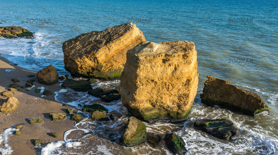 Several huge limestone stones by the sea