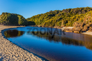 Picturesque pond on the beach