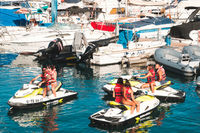 Group of young people on jet ski at boat and yacht harbour