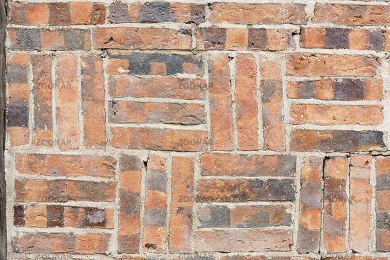 Bricks at a half-timbered house as background