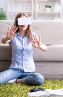 Young girl playing virtual reality games
