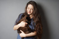 happy young woman with her pet cat