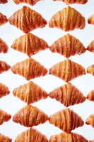Rhombus french croissants pattern on a light background.
