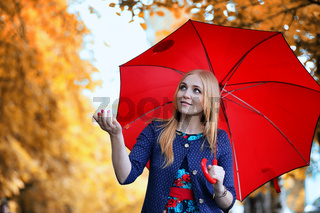 Girl in the street with an umbrella