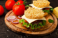 Burger with ramen, salad and tomatoes