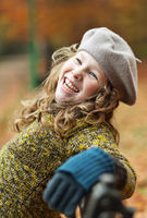 Smiling girl in grey beret