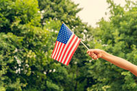 Child's hand with american flag