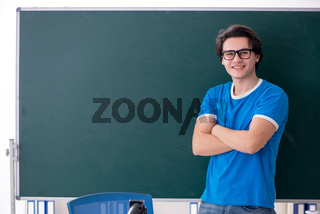 Young male student in the classroom