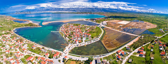 Historic town of Nin laguna and salt fields aerial panoramic view