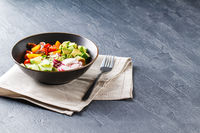 Vegan buddha bowl. Healthy vegetarian salad with cherry tomatoes, cucumber, radish,, avocado and lettuce.