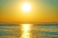 Bright sun over the sea