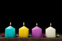 Multicolored burning candles