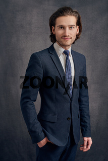 Young man in suit looking at camera