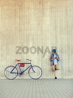 man with smartphone, earphones and bicycle