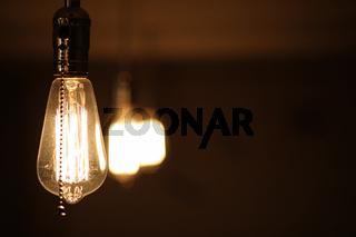 Lamps with tungsten filament. Edison's light bulb. Filament fila