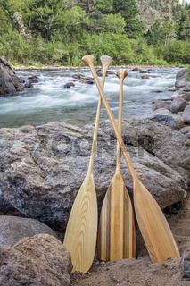 wooden canoe paddles and mountain river