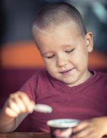 Portrait of a boy eating ice cream