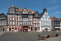 people in the market square in the old town of butzbach germany