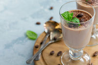 Coffee Panna cotta with a sprig of mint in the glass.