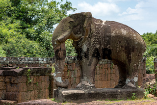 Elephant statue at corner of ruined temple