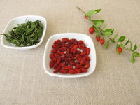 Dried goji berries and goji leaves